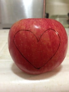 Drawing a heart on a apple